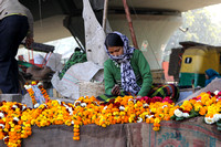 Woman Making & Selling Fresh Marigold Flower Necklaces